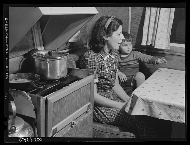 Mrs. Burton and her child, inside trailer (see caption #42581-D). Bath, Maine