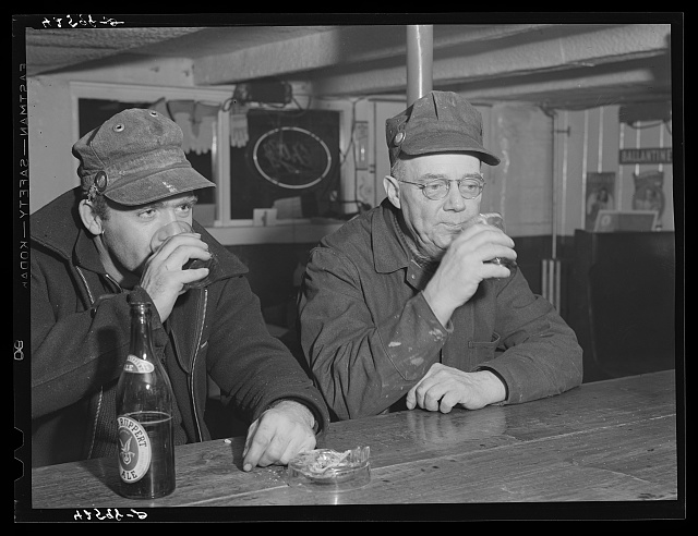 "Shipyard workers stop in for a ""beer"" after work. In a bar just outside the Bath Iron Works. Bath, Maine"