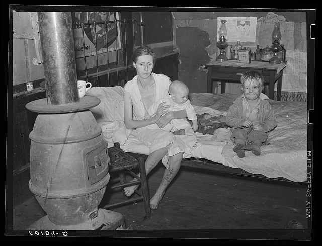 Wife and two children of unemployed mine worker. She has TB and syphilis. They are one of five families living in old abandoned company store in abandoned mining community of Marine, West Virginia