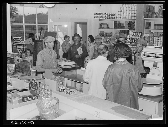 Buying groceries in community store. Tygart Valley, West Virginia