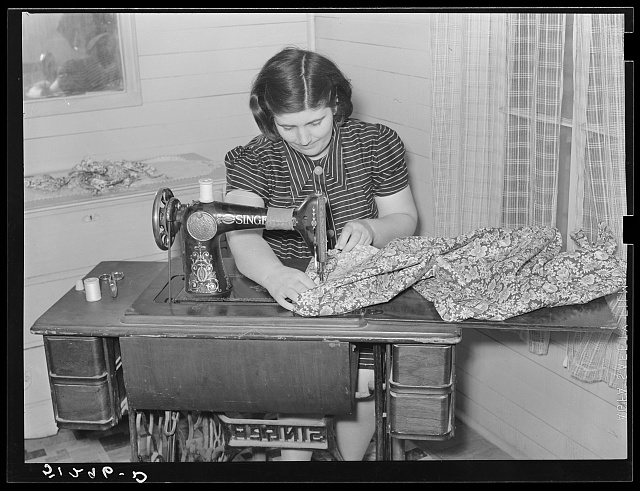 Mrs. Helms making dress. She does all her family sewing on new machine. FSA (Farm Security Administration) client. Coffee County, Alabama