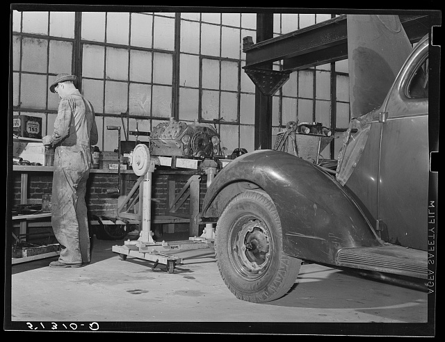 Repairing automobile motor. FSA (Farm Security Administration) warehouse depot. Atlanta, Georgia