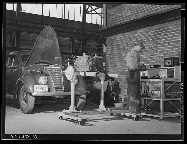 Repairing automobile motor at FSA (Farm Security Administration) warehouse depot. Atlanta, Georgia