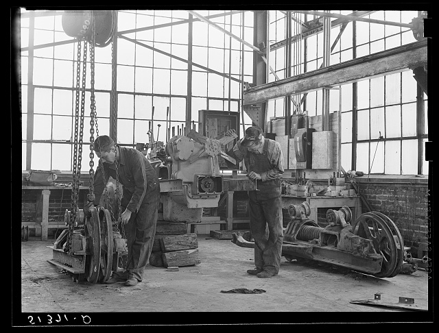 Repairing tractor. FSA (Farm Security Administration) warehouse depot. Atlanta, Georgia