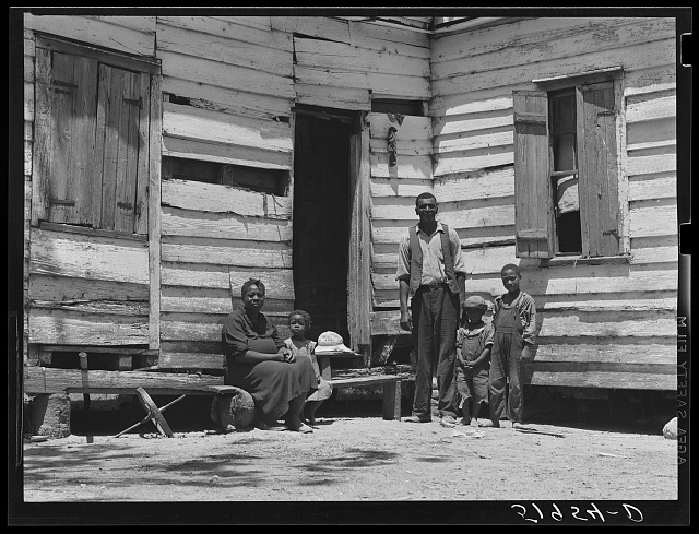 Mrs. Brown and family. She paid her taxes with oranges raised on her farm. Her husband worked in nearby oyster beds. The soil on the farm is better than usual in that section. Saint Helena Island, Beaufort, South Carolina