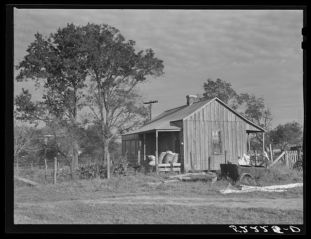 Home of Negro wagehand, Knowlton Plantation, Perthshire. On the porch are sacks of cotton. Mississippi Delta, Mississippi