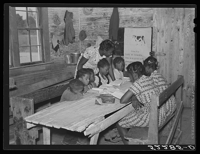 Interior of school on Mileston Plantation. School begins very late in the year and the attendance is poor until December because the children pick cotton. Mileston, Mississippi Delta, Mississippi