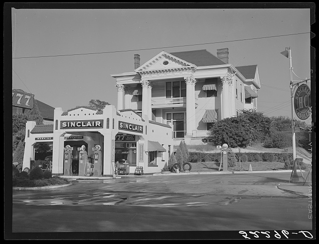 Gas station in front of old colonial house. Jackson, Mississippi Delta Mississippi