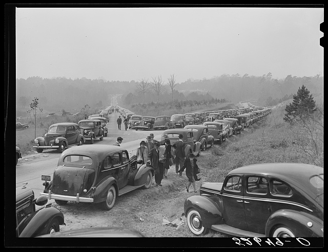 Cars parked along the highways on day of Duke-Carolina football game, near Duke University Stadium