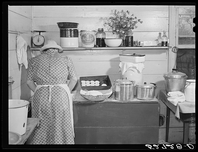 One of the Wilkins family making biscuits for dinner on cornshucking day at Mrs. Fred Wilkins' home near Tallyho, Granville County. North Carolina