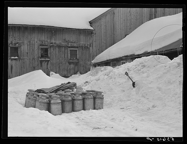 Farmhouse and milk cans near Saint Johnsbury, Vermont