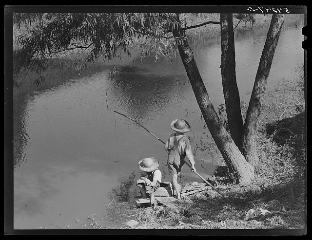 Cajun children fishing in a bayou near the school by Terrebonne Project. Schriever, Louisiana