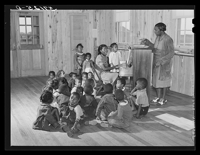 Singing and music for agricultural workers' children in new day nursery at Okeechobee migratory labor camp. Belle Glade, Florida