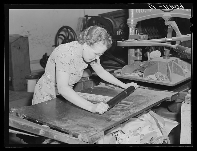 Editor of the Valley News inking column of type. Browns Valley, Minnesota