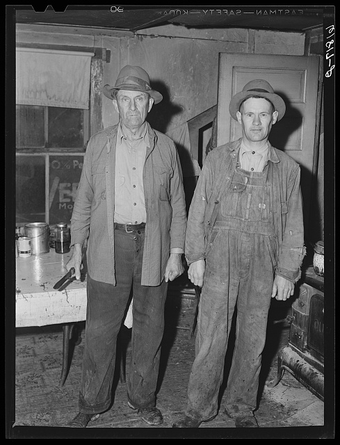 H.C. Richardson and helper. Ozark farmer, earns living on goats and pigs. Oregon County, Missouri