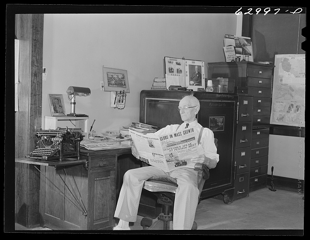 John W. Dillard, real estate and insurance man, and member of local Townsend Club, in his office at Washington, Indiana
