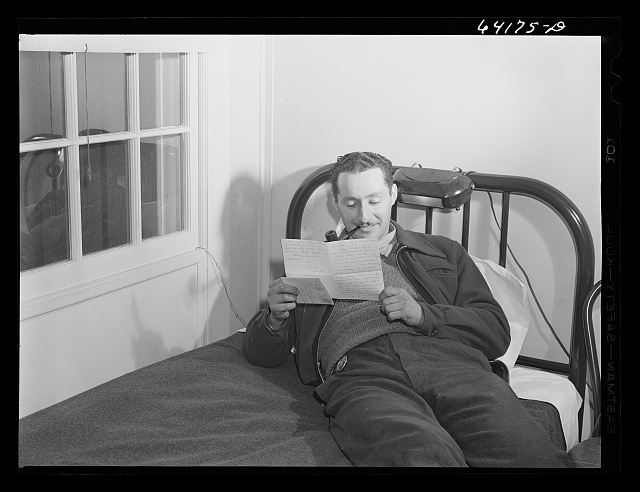 Defense worker reading a letter from home. He works at the proving grounds in Aberdeen, Maryland and lives in one of the FSA (Farm Security Administration) dormitories for defense workers