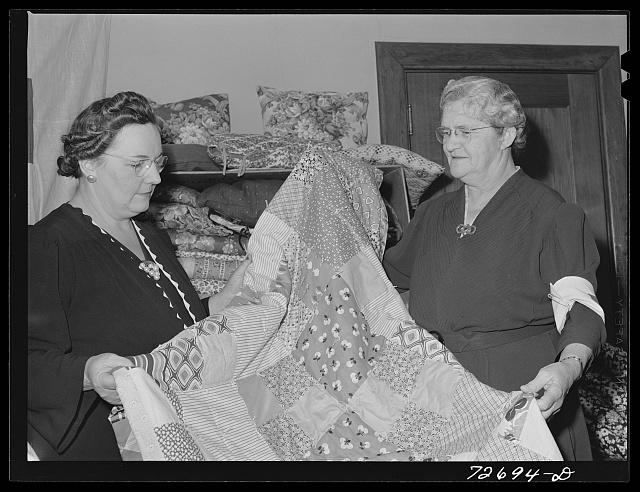 Turlock, California. Housewife (left) with some of the quilts the PTA (Parent Teacher Association) has made for the Red Cross. She is president of PTA