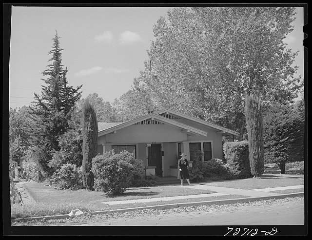 Turlock, California. Housewife leaves her home for shopping trip to town. She walks, leaving the automobile in the garage, saving it for those occasions when all the family can use it to advantage