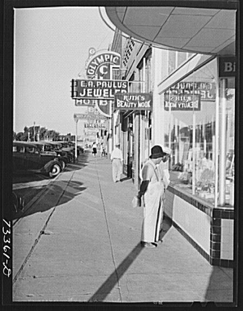 Nyssa, Oregon. Japanese-Americans who live at the FSA (Farm Security Administration) mobile camp shopping in Nyssa. Local merchants say the Japanese-Americans are heavy spenders and have practically bought the town out