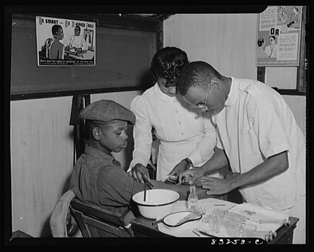 Bridgeton, New Jersey. FSA (Farm Security Administration) agricultural workers' camp. Patients at the camp clinic receiving injections for the treatment of venereal diseases