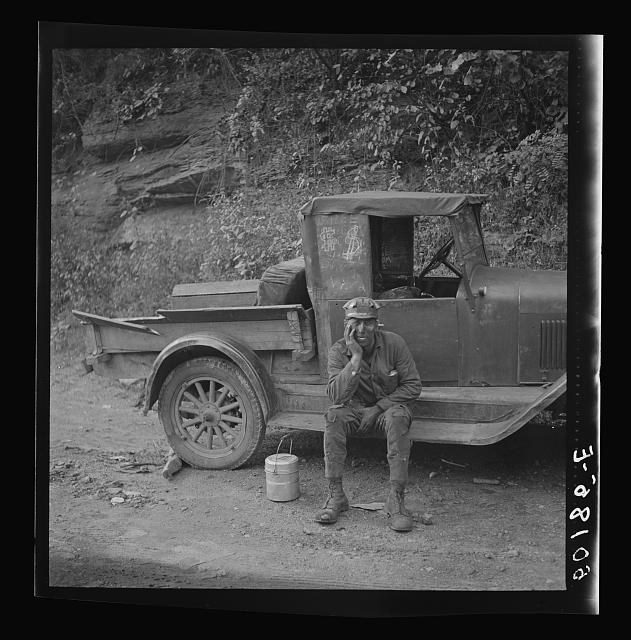 Miner waiting for ride home. Each miner pays twenty-five cents a week to owner of car. Capels, West Virginia