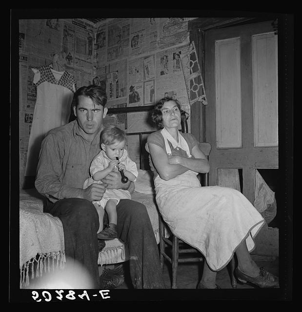 Coal miner, his wife and one of their many children. Bertha Hill, West Virginia