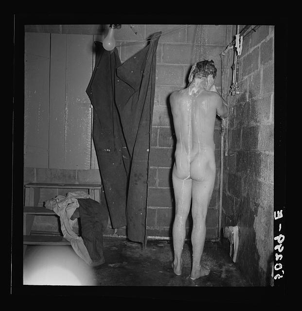 Miner takes shower, which he built in the cellar of his home. Westover, West Virginia