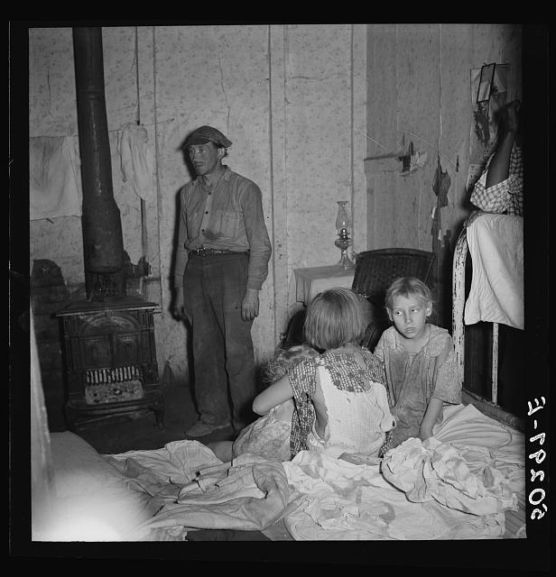 Coal miner and three of his children. Pusglove, West Virginia. See 50294-E