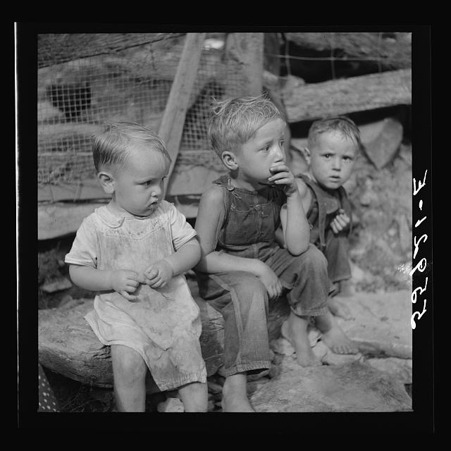 Mountain children on stone steps of their home. Up Stinking Creek, Pine Mountain, Kentucky