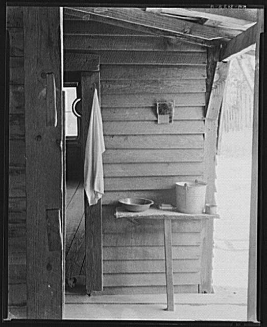Washstand in the dog run of Floyd Burroughs' cabin. Hale County, Alabama