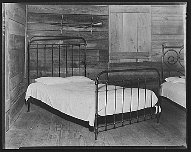 Part of the bedroom of Floyd Burroughs' cabin. Hale County, Alabama