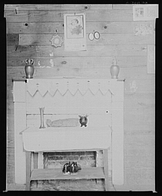Fireplace and wall detail in bedroom of Floyd Burroughs' cabin. Hale County, Alabama
