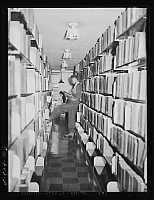 Atlanta University, Atlanta, Georgia. Students in library stacks