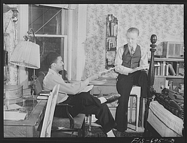Chicago, Illinois. Two of a group of young men who live in cooperatively in large house