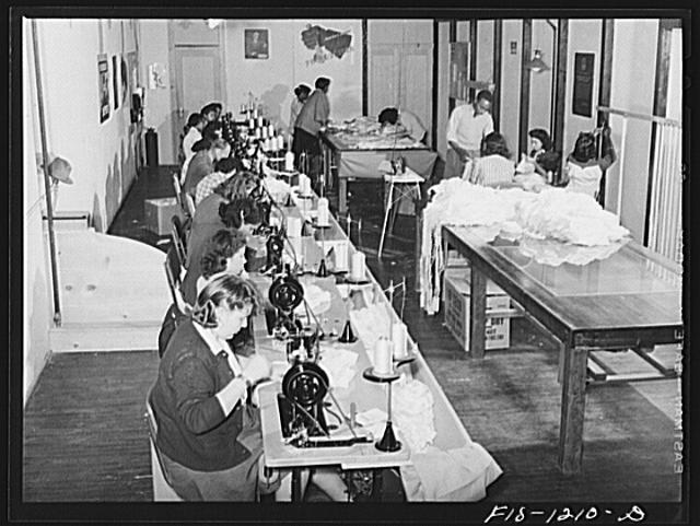 Workroom of the Pacific Parachute Company, manufacturers of pilot parachutes. San Diego, California