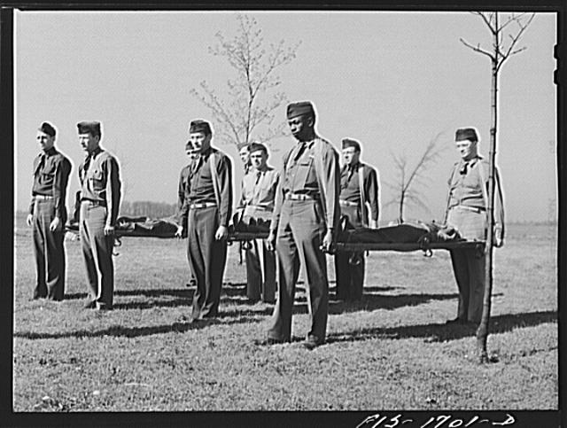 Chaplains being instructed in the proper use of stretchers during a first aid class at the U.S. Army chaplain school. Fort Benjamin Harrison, Indiana