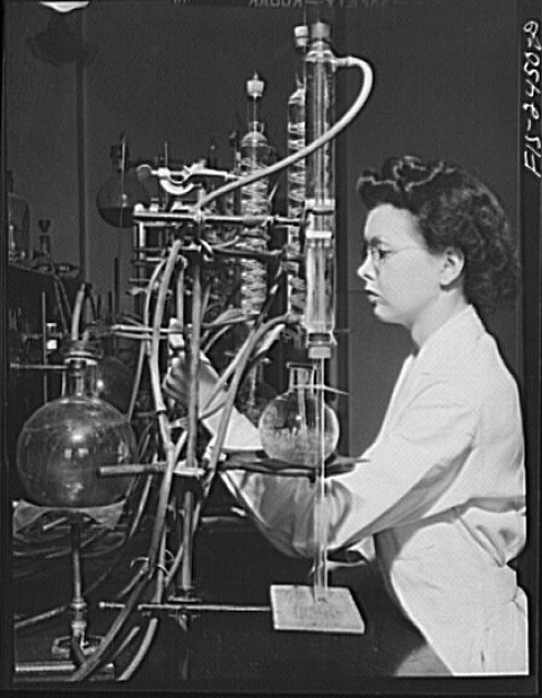 Miss Jeanne Dougherty, graduate in Bacteriology, working in the laboratory in the Dairy Industry Department. She is conducting experiments on the effects of acids on flavor of butter. Iowa State College. Ames, Iowa