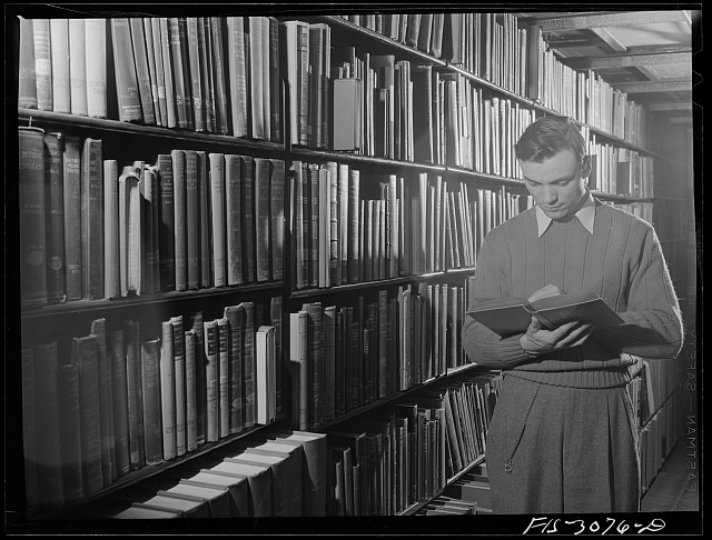 Bob Aden in the library. University of Nebraska, Lincoln