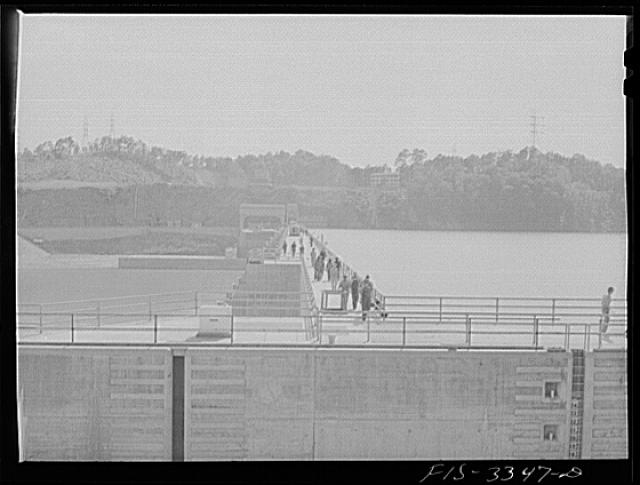 Watts Bar Dam, Tennessee. Tennessee Valley Authority (TVA). Workers crossing the dam