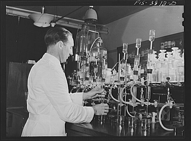 Dr. G.I. Jones, associate chemist, conducts tests in determination of vitamin B complex in dehydrated vegetables. Regional agricultural research laboratory, Albany, California. This test must be conducted in light of certain quality which will not destroy vitamins in solution