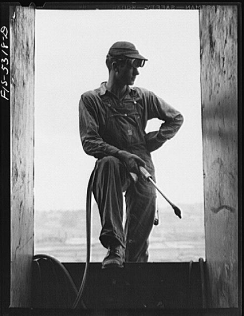 Decatur, Alabama. Ingalls Shipbuilding Company. A young tacker working on one of the barges