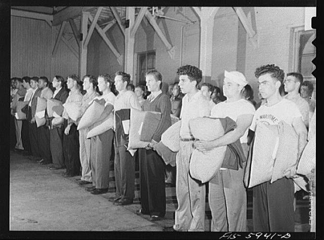 Hoffman Island, merchant marine training center off Staten Island, New York. New arrivals with bedding just issued to them