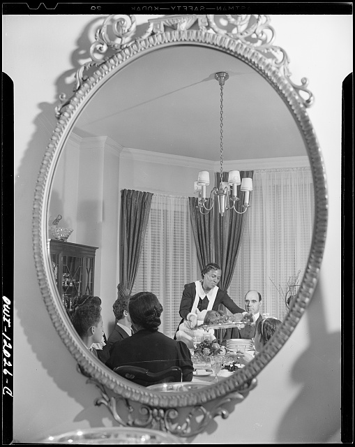 Washington, D.C. A maid in the home of Dr. Mordica Johnson, president of Howard University, placing before him the Thanksgiving turkey