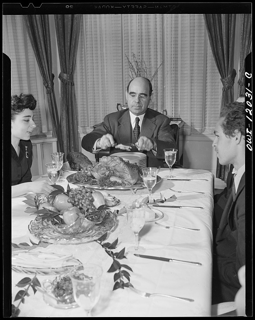 Washington, D.C. Dr. Mordica Johnson, president of Howard University, serving portions of Thanksgiving turkey to members of his family