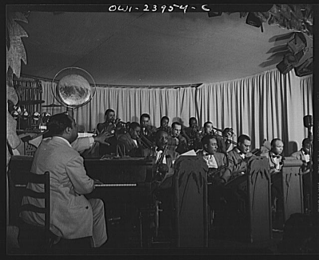 New York, New York. Duke Ellington directing his band from the piano