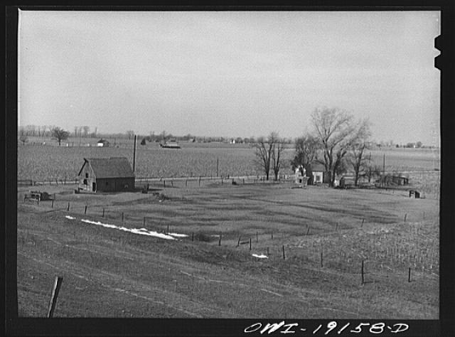 Farm landscape along the Atchison, Topeka and Santa Fe Railroad tracks near Carrollton, Missouri