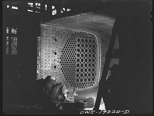 Topeka, Kansas. Welder working on a fire box of an engine in the Atchison, Topeka and Santa Fe Railroad locomotive shops