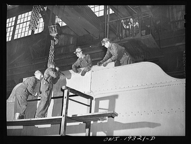 Topeka, Kansas. Working on the tender for an engine in the Atchison, Topeka and Santa Fe Railroad locomotive shops