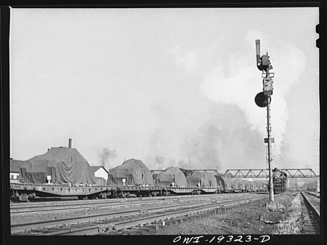 Kansas City, Kansas. Military tanks on their way through the Atchison, Topeka and Santa Fe Railroad yard